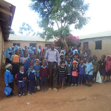 Volunteer in a school where vulnerable children need help in