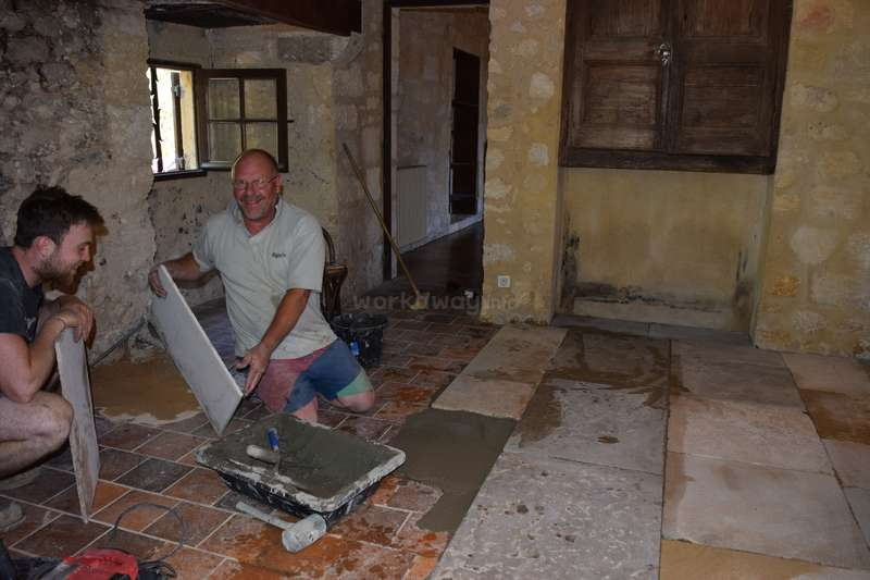 laying stone pavers over nasty 1970s tile
