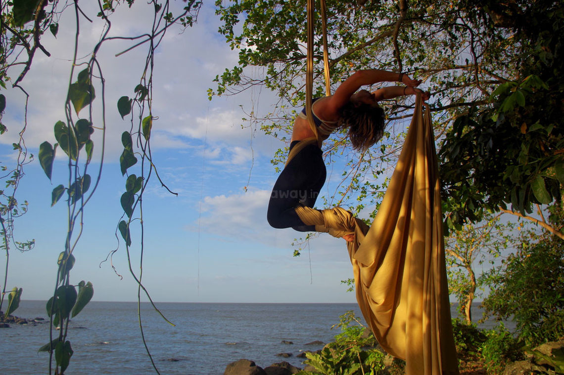 girls swinging from yellow clothe ropes in costa rica