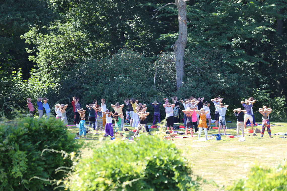 large group yoga in community in sweden