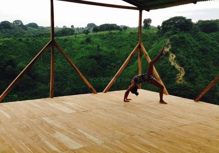 ecuador yoga pose against green backdrop