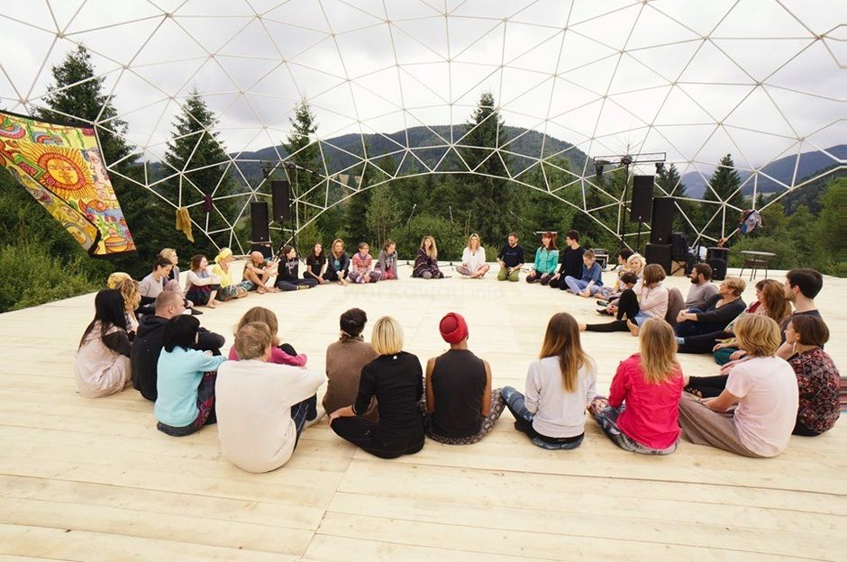 group of yogis with mountain view in ukraine