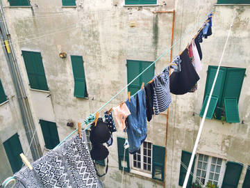 clothes hanging between buildings
