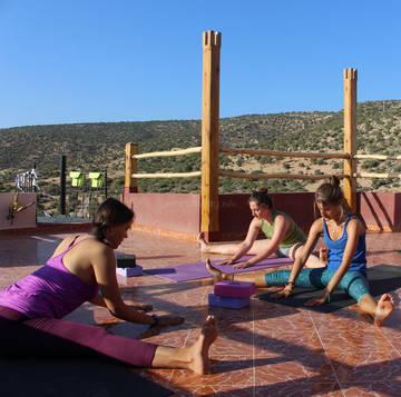 yogis practicing yoga in moroccan surf school