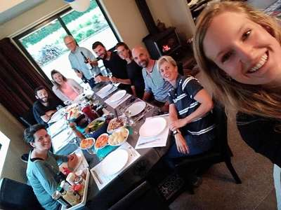 blogger couple sharing meal with workaway family