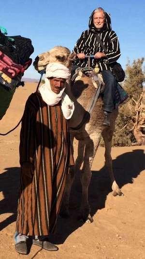 workawayer riding a camel