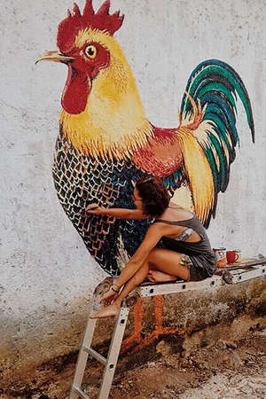 workawayer painting rooster mural