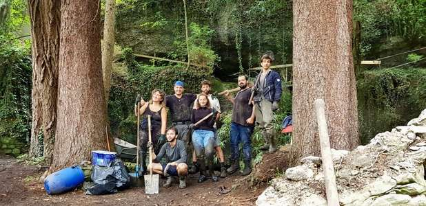 workaway group in the woods with tools