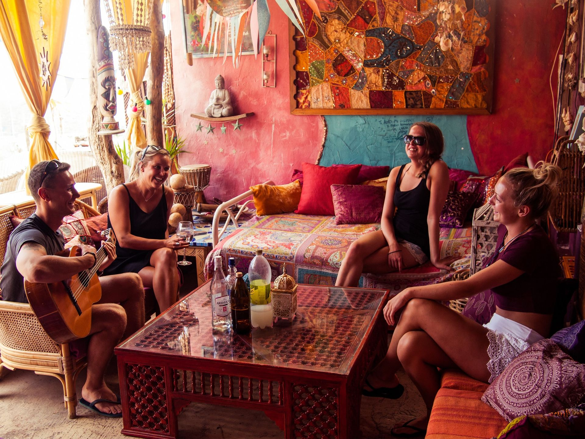 volunteer travel tribe enjoy conversation and guitar music colourful lounge