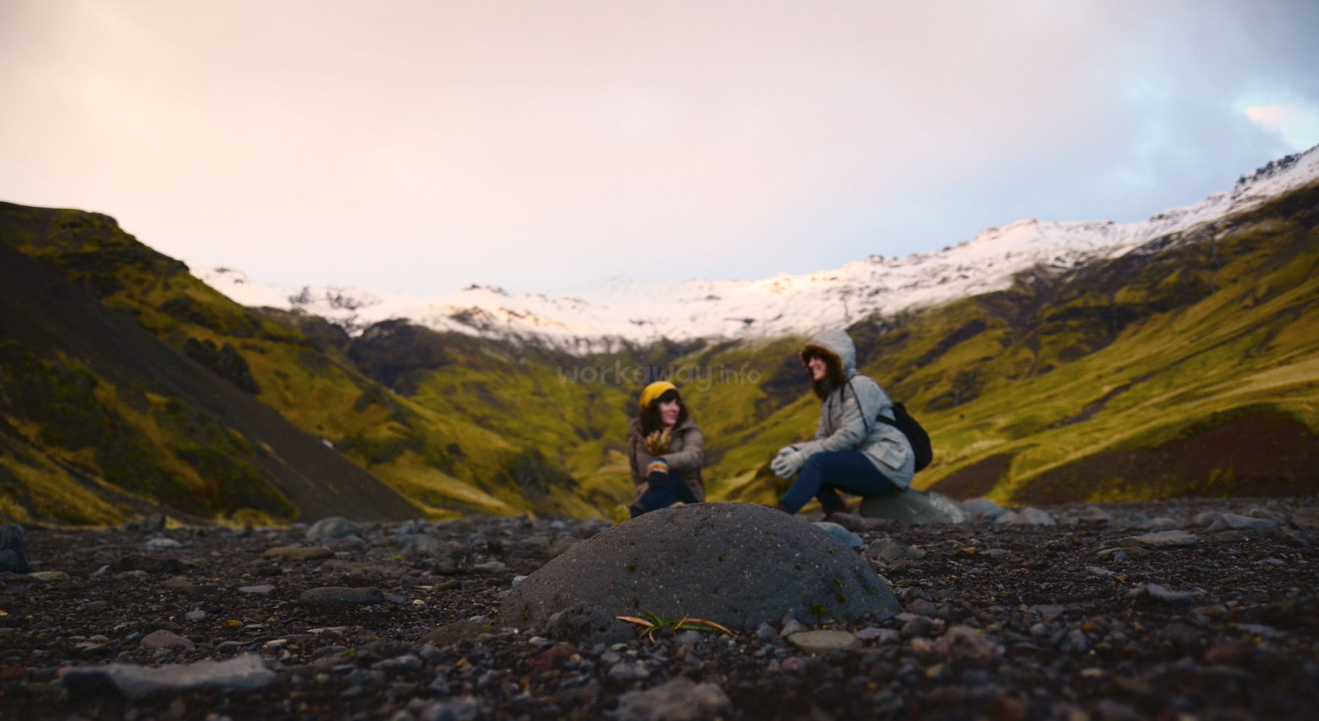 female workawayers chatting and enjoying mountain scenery