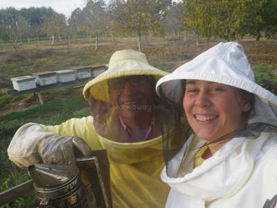 workawayer with host in beekeeping wear