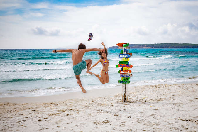 travel local beach couple happiness jump