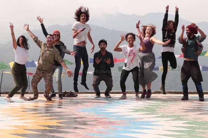 workaway volunteer community group jump photo