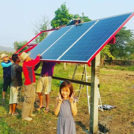 setting up solar panels with workaway host daughter