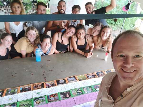 workaway host teach permaculture class to volunteers thailand