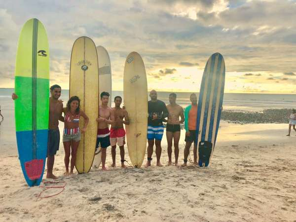 workaway multicultural travel group beach surfing