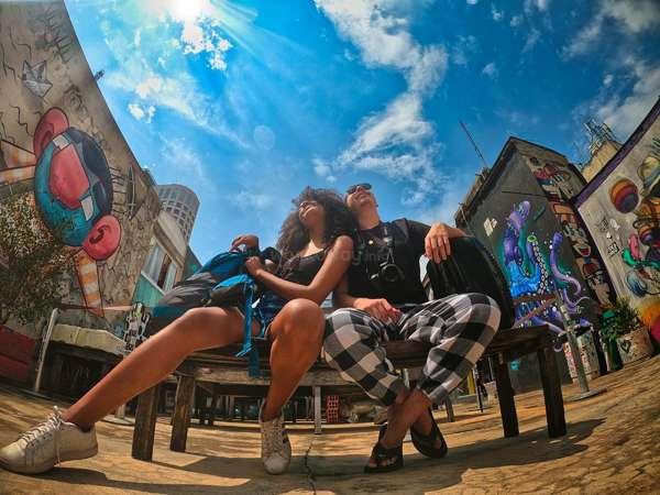 workaway backpacking couple admire graffiti art Brazil