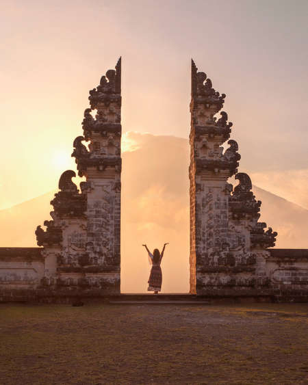 solo female taveller Bali admire heritage temple sunset