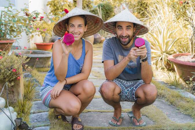 career break couple dragonfruit picking vietnam