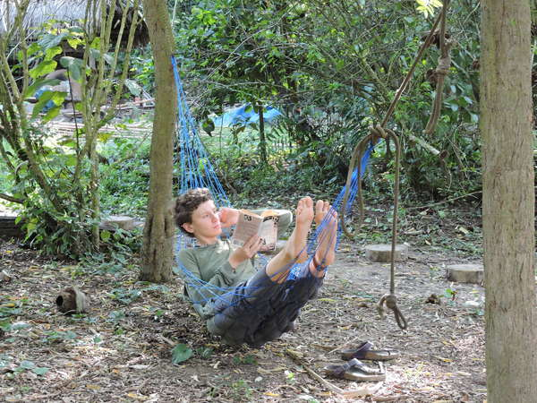 unplugged traveller in amazon jungle relax hammock with book