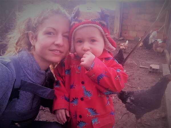 ranch life with fenia and toddler Adam in chicken coop farm ranch