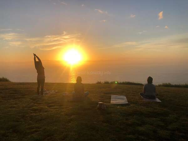 stretch relax nature grass yoga group trio enjoy sunset over sea