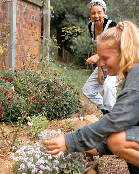 women who travel simple happiness gardening picking flowers outdoors nature laughter