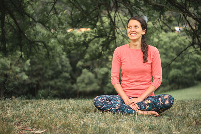 workaway solo female yoga retreat experience health fitness wellness outdoor cross legged on grass