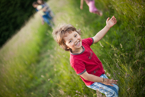workaway host little boy introduce travellers around home meadow nature