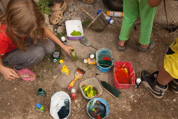 artistic fun workaway children out in nature mixing paint homeschooling fun