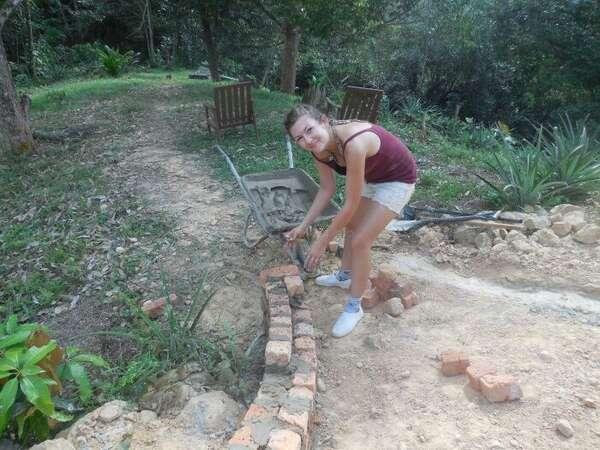 workawayer solo female building volunteer brick laying garden