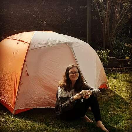 solo female camping outdoor adventure enjoy tea