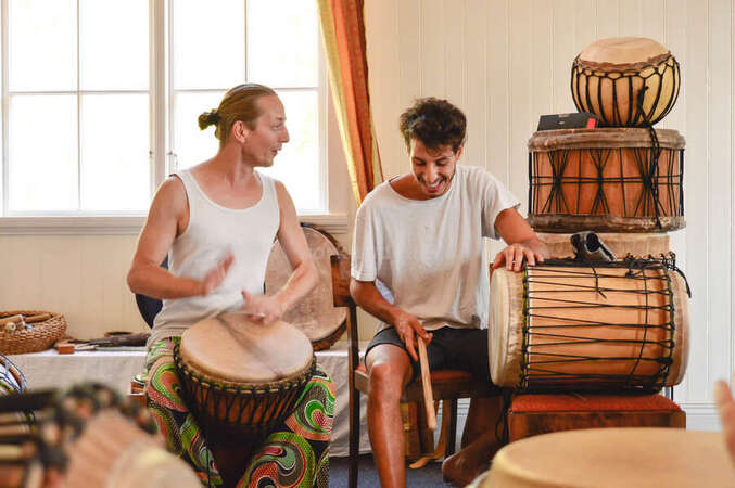 playing djambe drums with workaway host learning culture music fun unique experience travel abroad