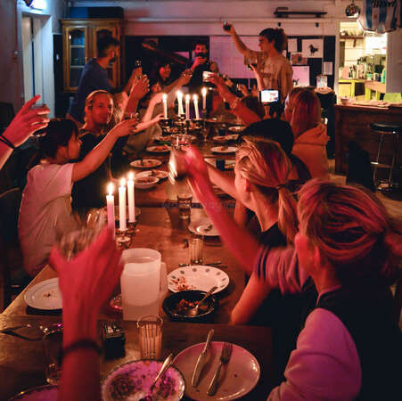 workaway family dinner night drinks candlelit celebration happiness host family