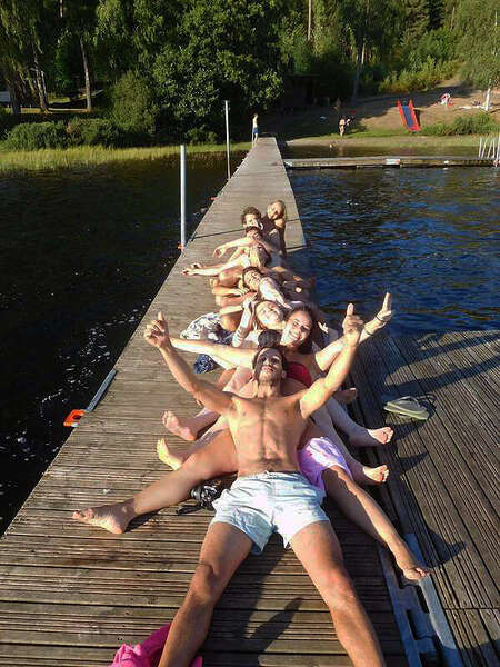 group activity workaway outing enjoy sunshine lying down community travel tribe adventure