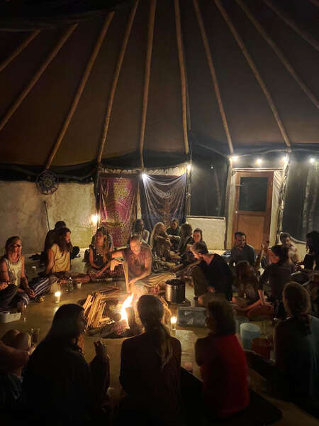 travel tribe chosen family campfire evening tent yurt discussion
