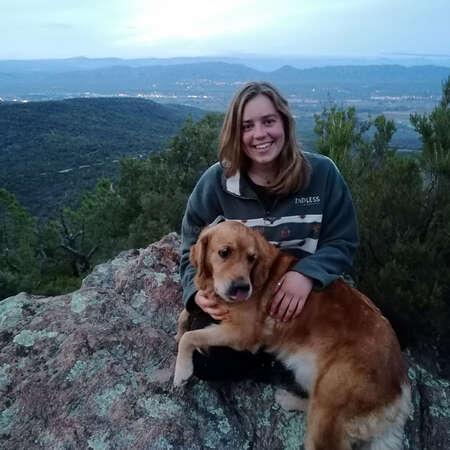workaway ambassador blog contributor Ellie mountain photo with dog