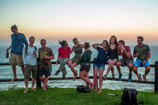 connection community life workawayer group travel tribe sunset over sea beers