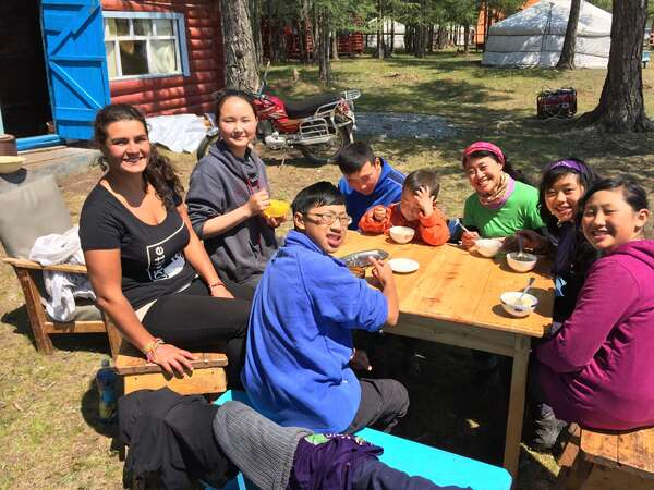 enjoy food outdoors during workaway break with friends and family