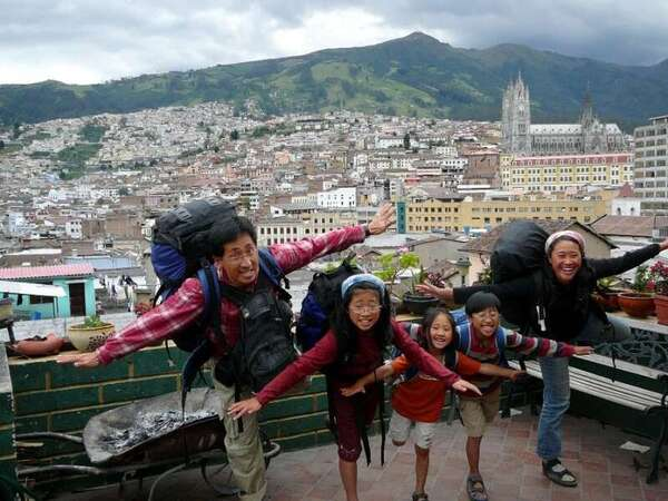 workaway backpacking family take flight pose on balcony